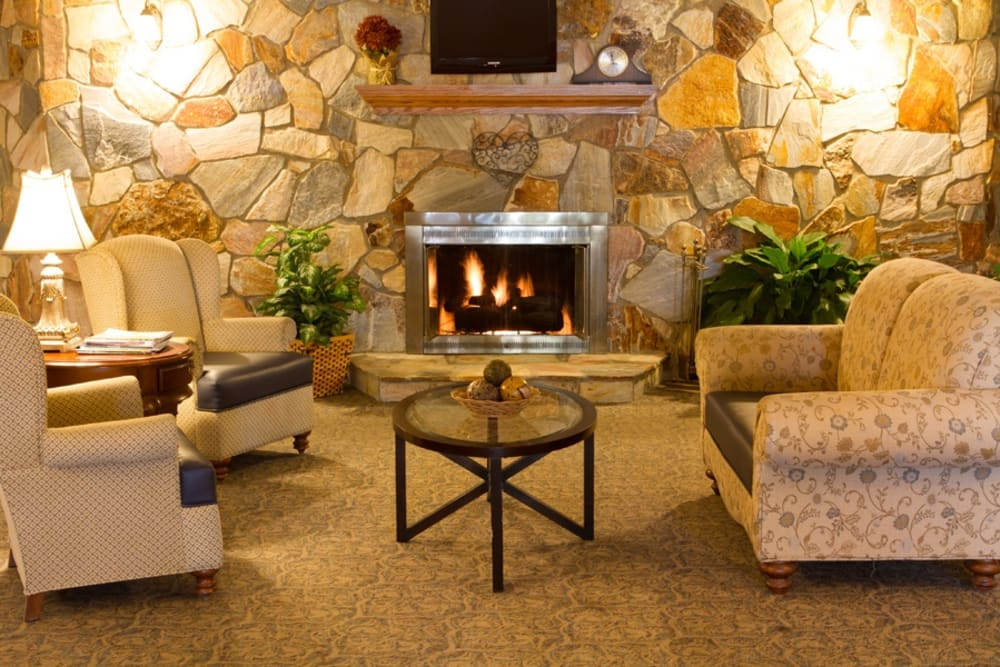 Warmly lit lounge with a fireplace at Royalton Woods in North Royalton, Ohio
