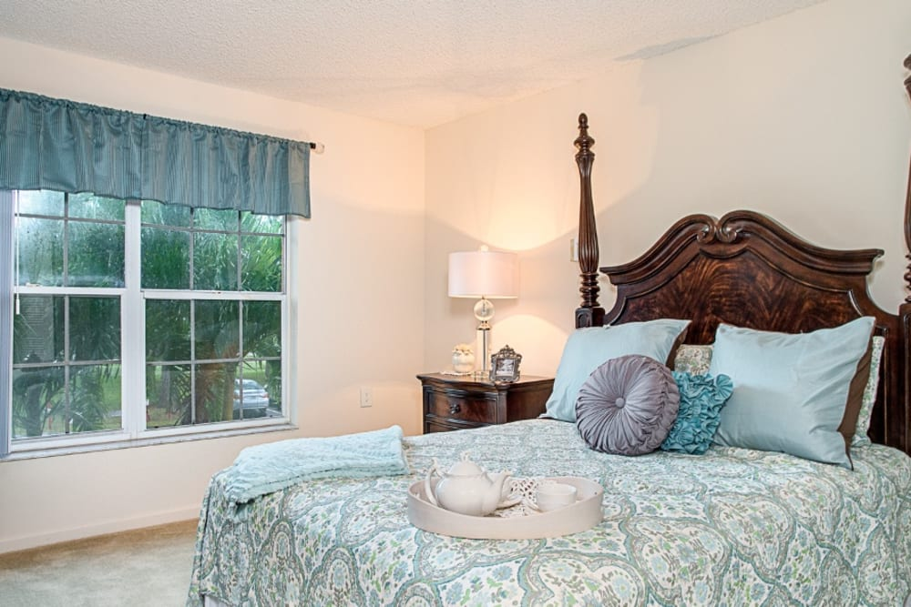 Bedroom model with blue bed at Grand Villa of Delray West in Florida