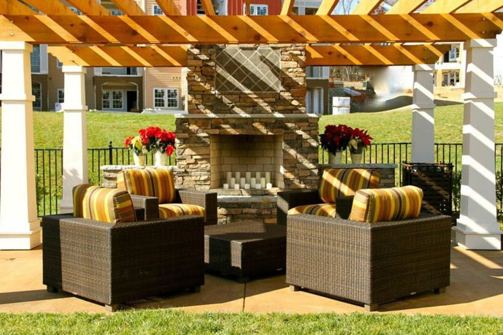 Outside fireplace and seating area at Integra Hills Apartment Homes in Ooltewah, TN