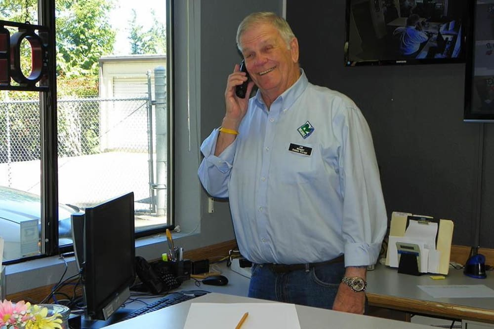 An employee talking on the phone to a customer at Reliable Storage in Bremerton, Washington