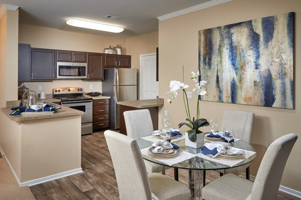 Kitchen with wood-style flooring at Legend Oaks Apartments in Aurora, Colorado