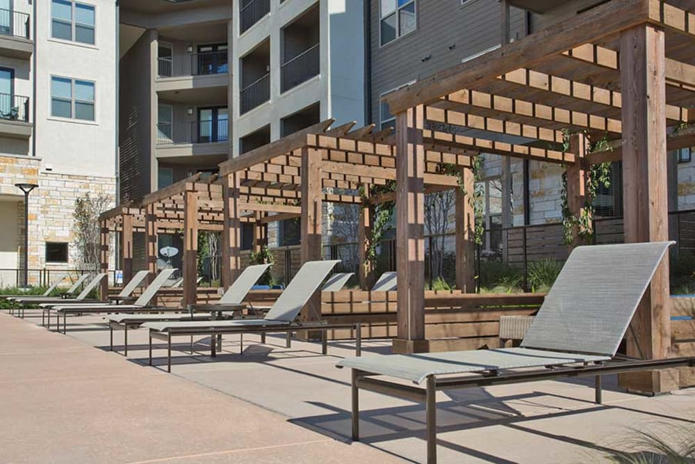 Lounge by the pool at Axis at The Rim in San Antonio, Texas