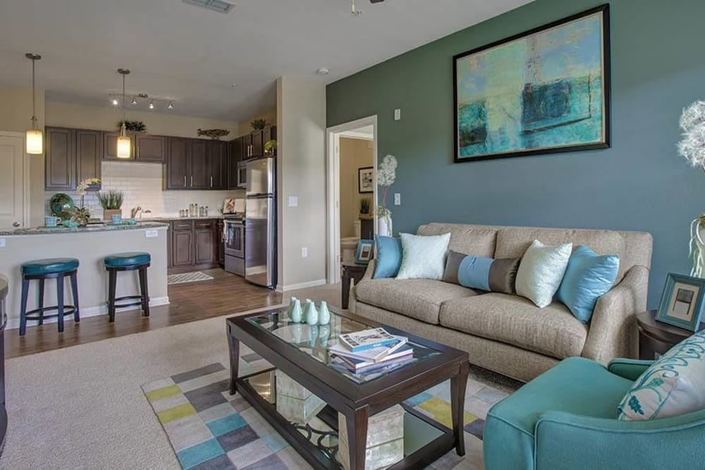 Living room at Integra Hills Preserve Apartments in Ooltewah, TN
