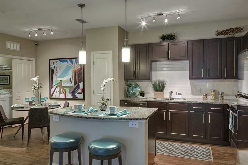 Breakfast bar and kitchen at Integra Hills Preserve Apartments in Ooltewah, TN