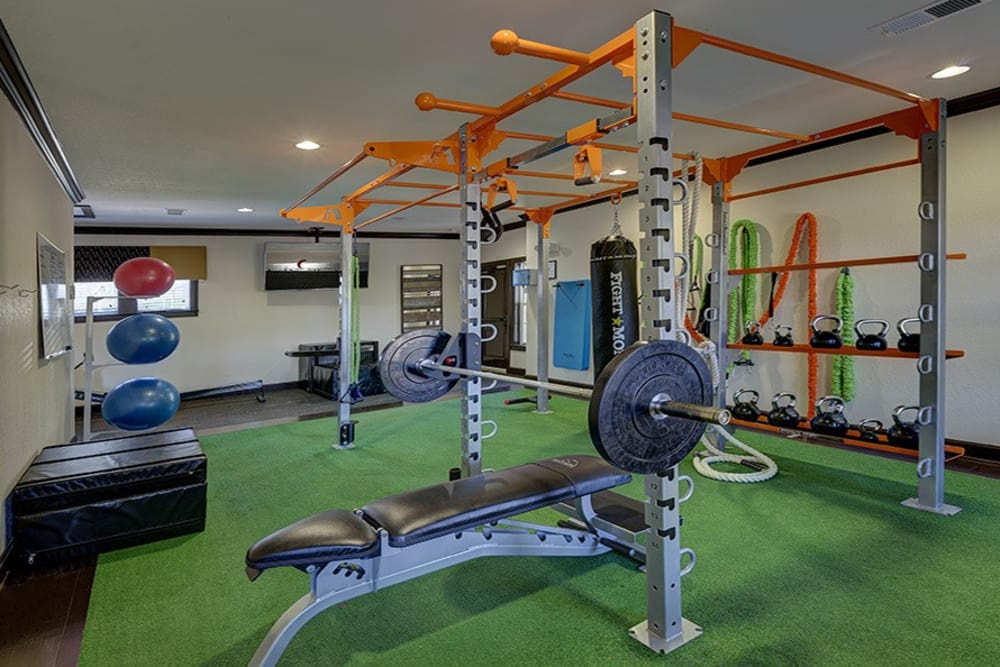 Fitness center at Integra Hills Preserve Apartments in Ooltewah, TN