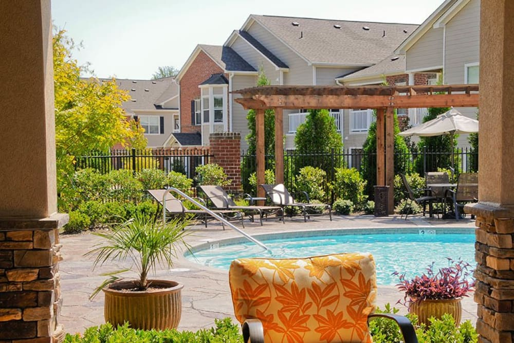 Sitting area by the pool at Villas at Houston Levee East Apartments in Cordova, TN