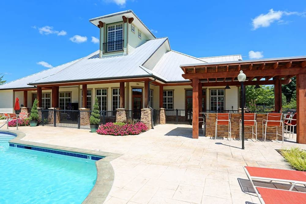 Clubhouse with pool at Huntsville Parc Apartment Homes in Huntsville, AL