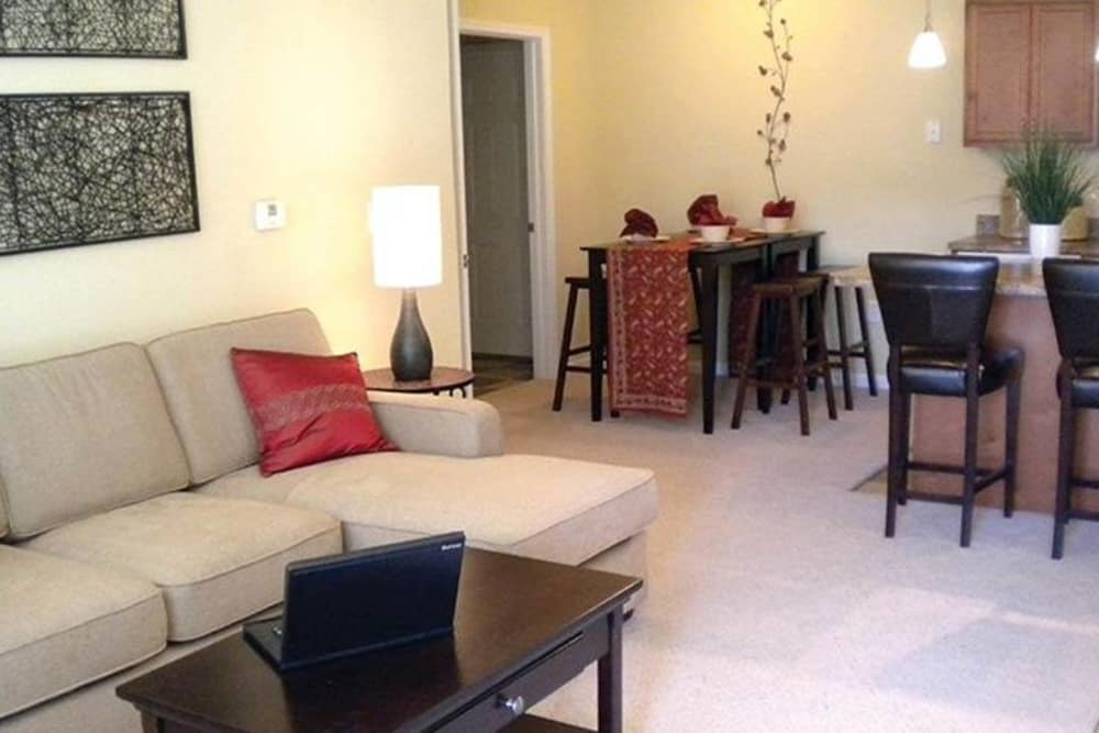 Living and dining room at Huntsville Parc Apartment Homes in Huntsville, AL