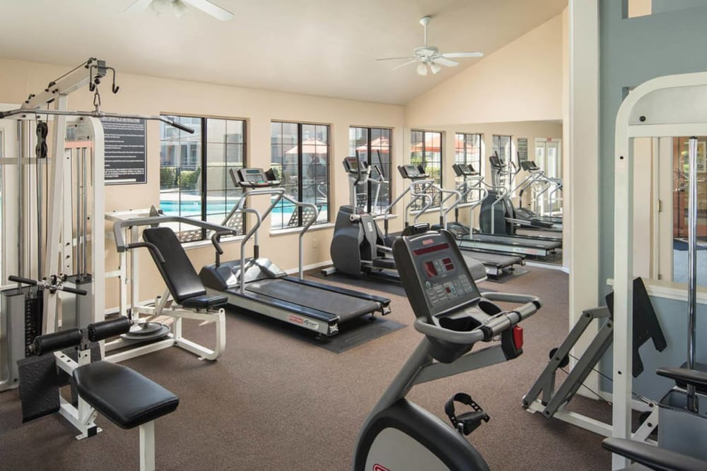 Fitness center with individual workout stations at Hidden Lake Condominium Rentals in Sacramento, California