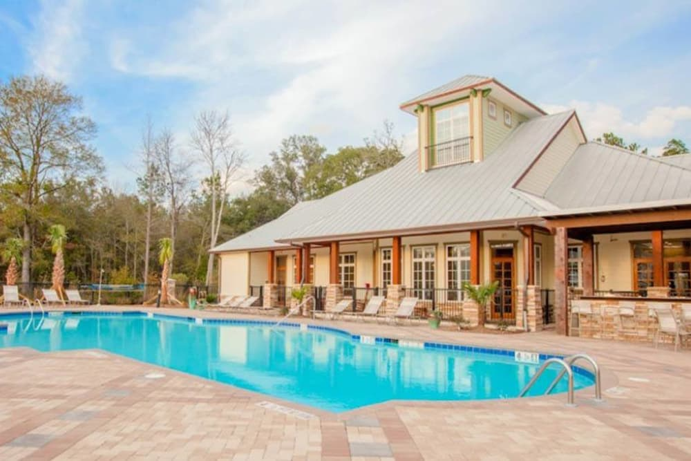 Swimming pool by the clubhouse at Panther Effingham Parc Apartments in Rincon, GA.