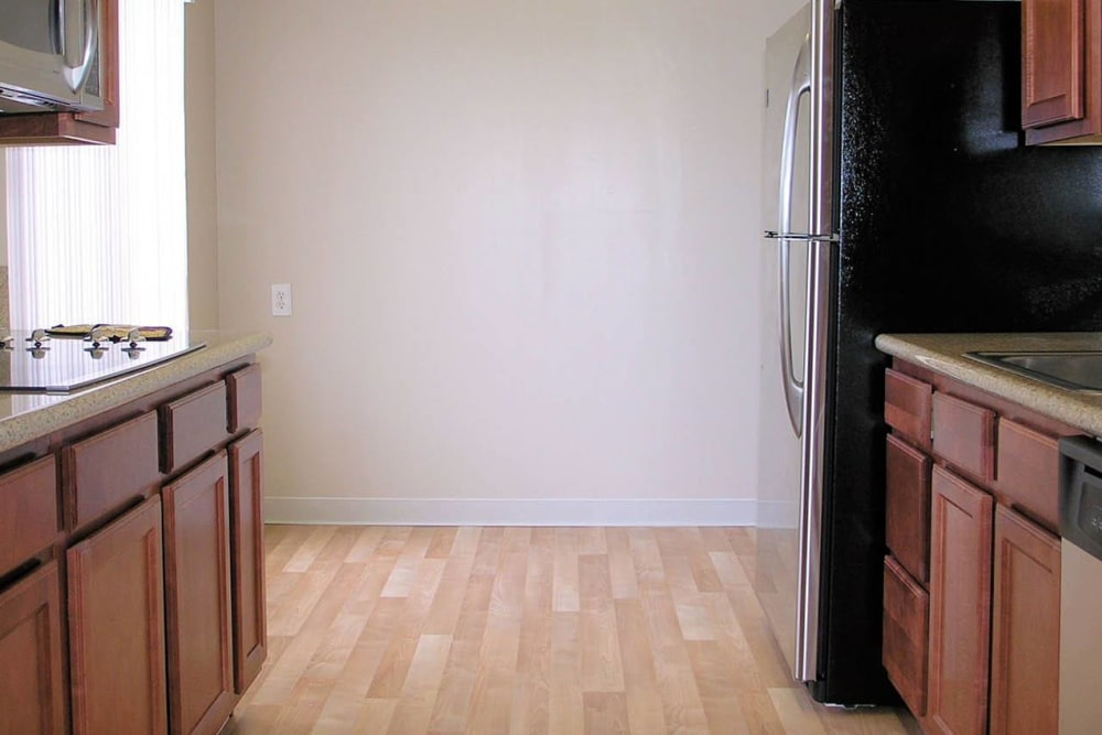 Kitchen with hardwood flooring at Tower Apartment Homes in Alameda, California