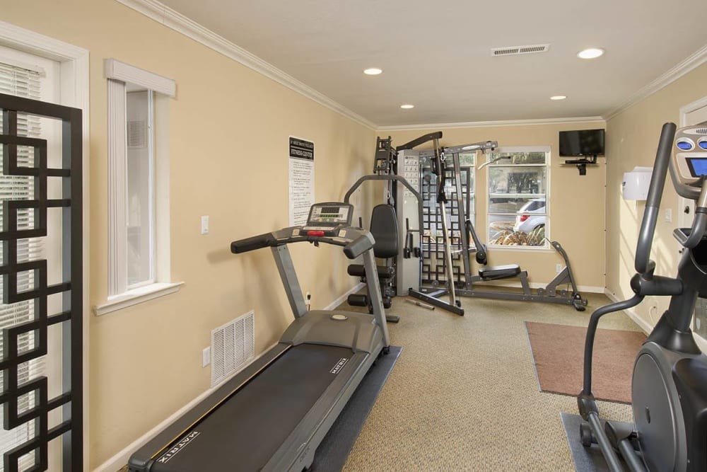 Fitness center with individual stations at Seventeen Mile Drive Village Apartment Homes in Pacific Grove, California