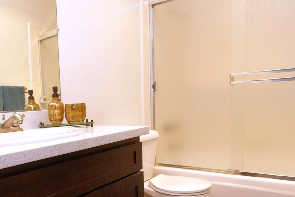 Bathroom with an oval tub at La Valencia Apartment Homes in Campbell, California