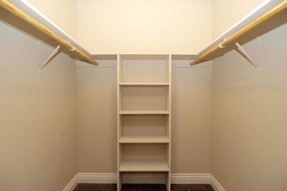 Walk in closet with built in shoe storage at Spring Lake Apartment Homes in Santa Rosa, California