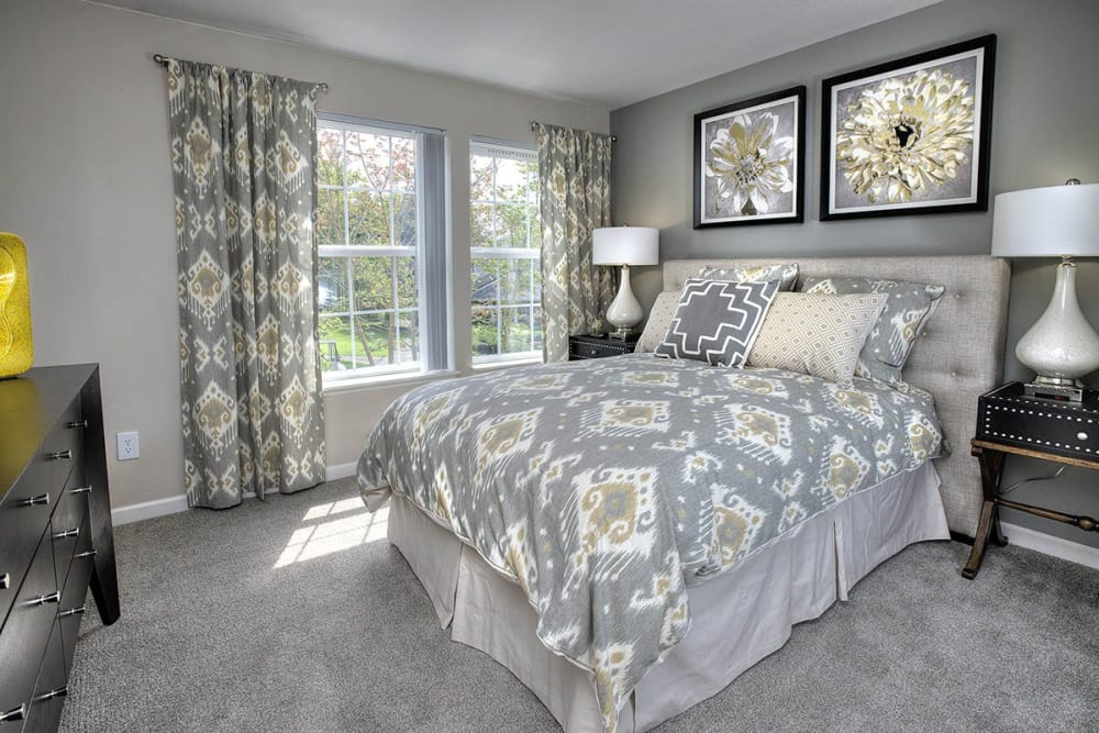 Beautifully decorated bedroom at Slate Ridge at Fisher's Landing Apartment Homes in Vancouver, Washington