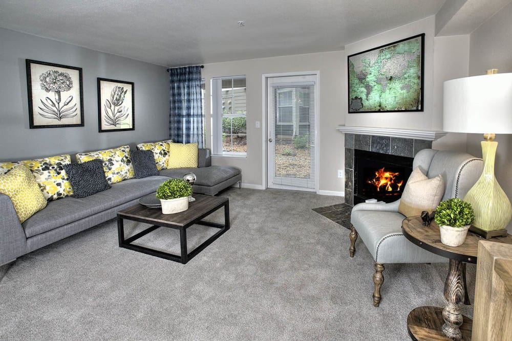 Luxurious living room with a fireplace at Slate Ridge at Fisher's Landing Apartment Homes in Vancouver, Washington