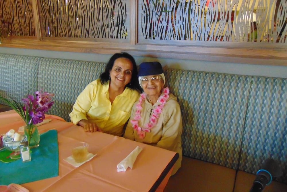 Resident and family member enjoying a meal at Merrill Gardens at Oceanside