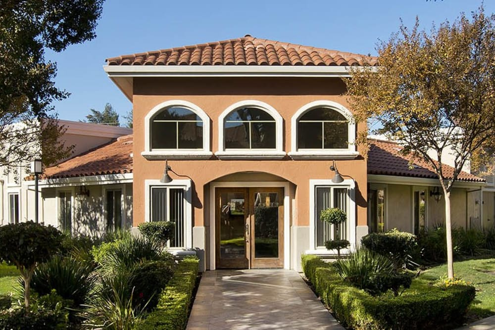 Spanish-style exterior of clubhouse at La Valencia Apartment Homes in Campbell, California