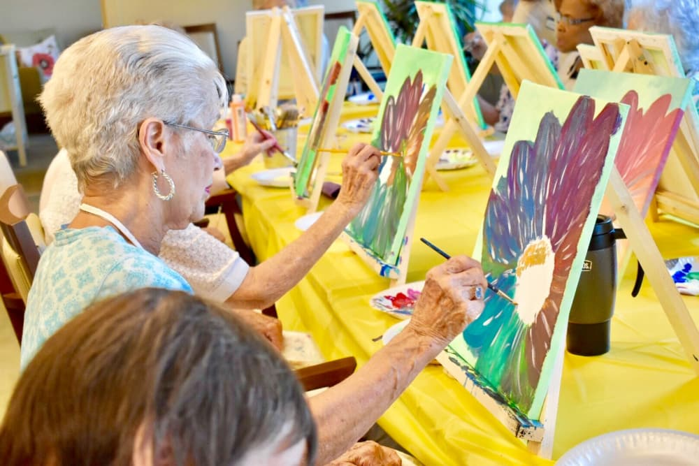 Active living residents enjoying a paint and sip at Merrill Gardens at Anthem