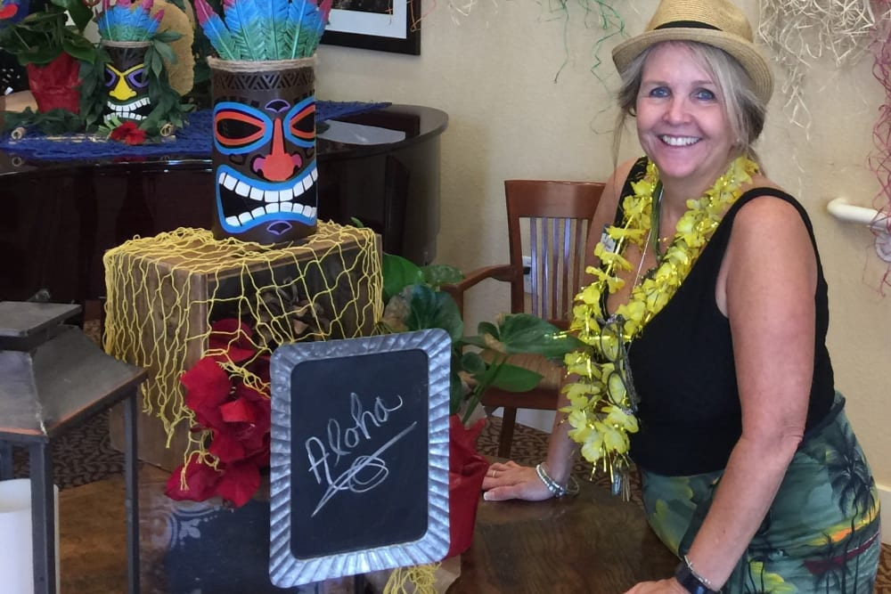 Pines team member at their annual luau party