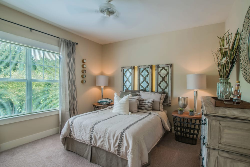 Inviting bedroom at Panther Riverside Parc Apartments in Atlanta, GA