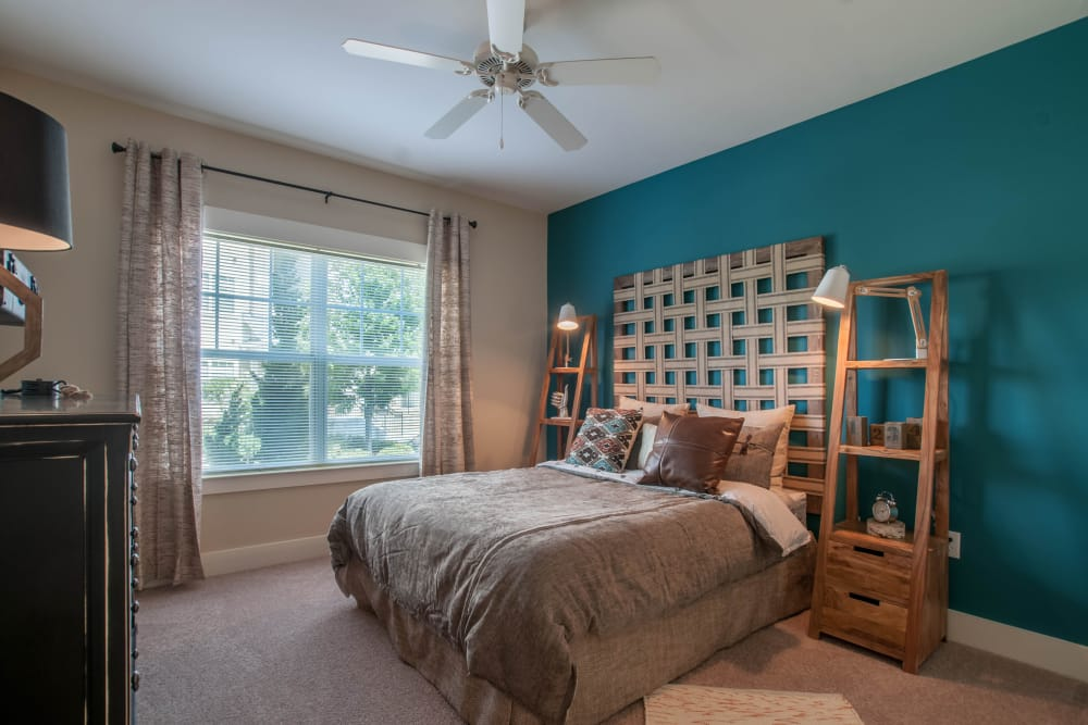Relax in your bedroom at Panther Riverside Parc Apartments in Atlanta, GA