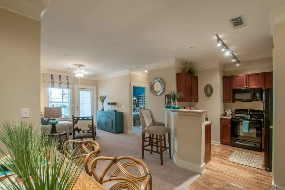 Dining room and kitchen at Panther Riverside Parc Apartments in Atlanta, GA