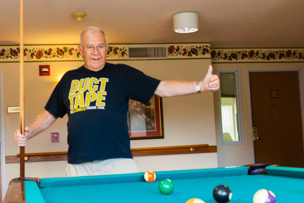 Resident enjoying a game of pool at Someren Glen