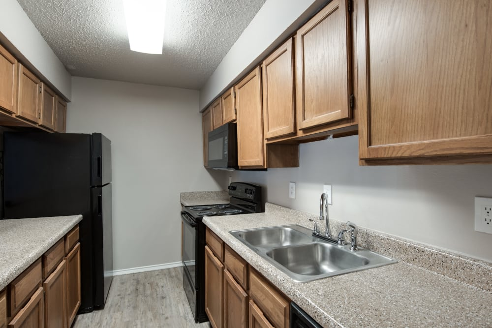 Apartment Kitchen at Wooded Creek