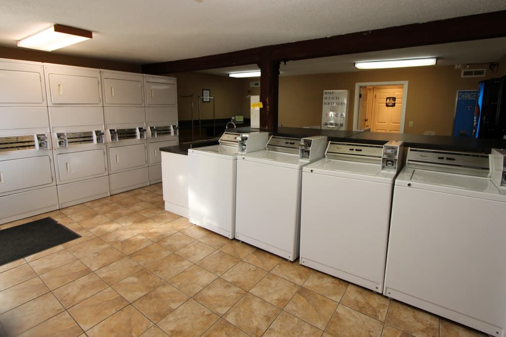 Spacious laundry facility at Village Green in Evansville, Indiana