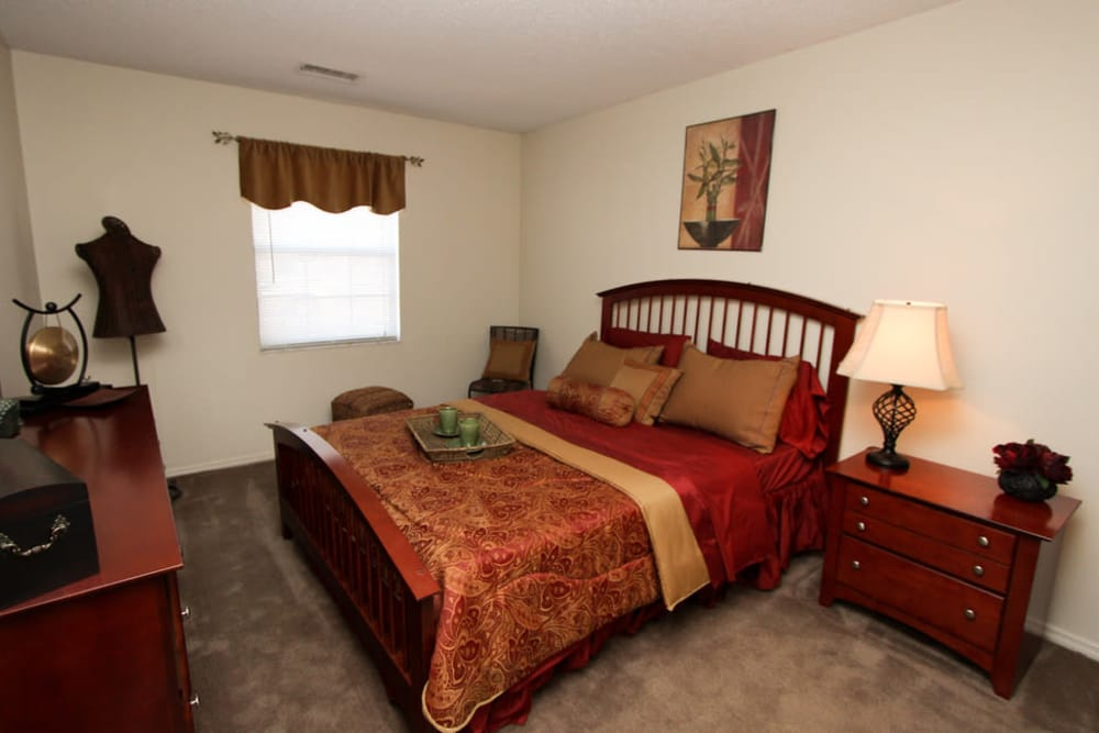 Cozy bedroom at Village Green in Evansville, Indiana
