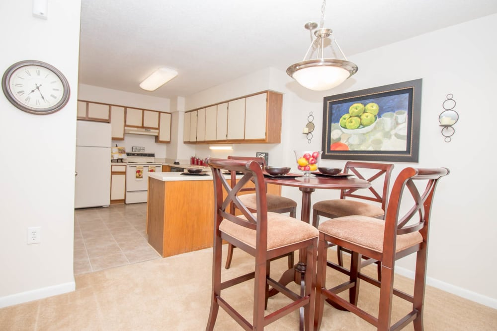 Dining and kitchen room at River Park Tower Apartment Homes in Newport News, VA