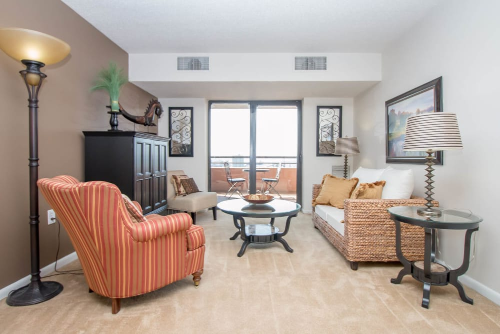 River Park Tower Apartment Homes offers a naturally well-lit living room in Newport News, VA
