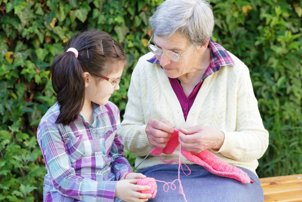 A little girls spends time with her grandmother at Comfort Residence