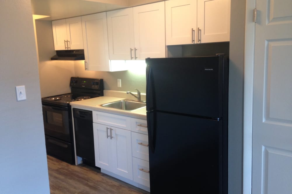 Modern kitchen in model home at Parkwood Plaza Apartments in Denver, Colorado