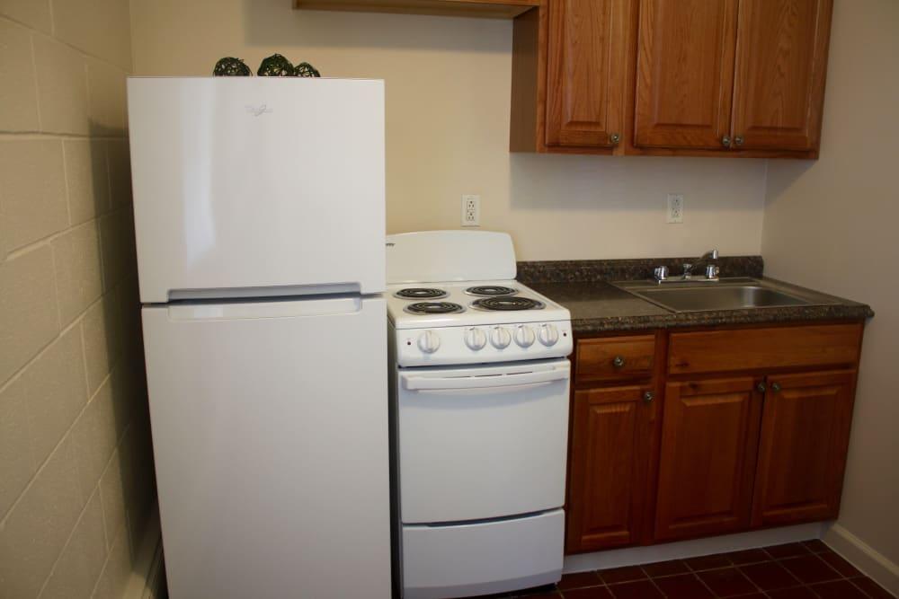 Small kitchen at apartments at Campus Edge at Brigham