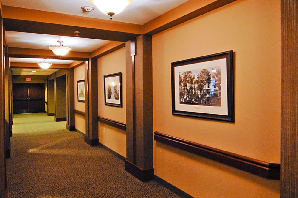 The hallway with green carpet at The Glenn Minnetonka