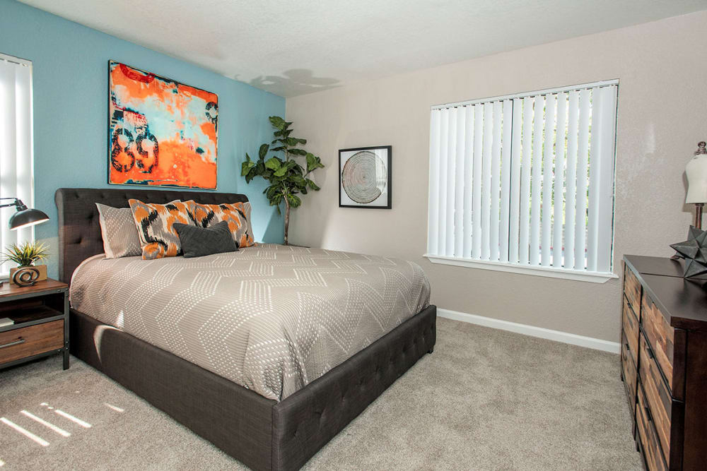 Bedroom with modern decor at Sandpiper Village Apartment Homes in Vacaville, California