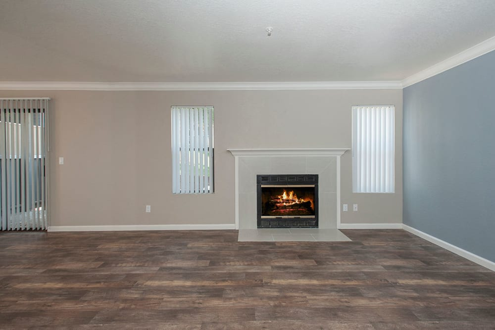 Living room with luxury features including a fireplace and hardwood flooring at Sandpiper Village Apartment Homes in Vacaville, California
