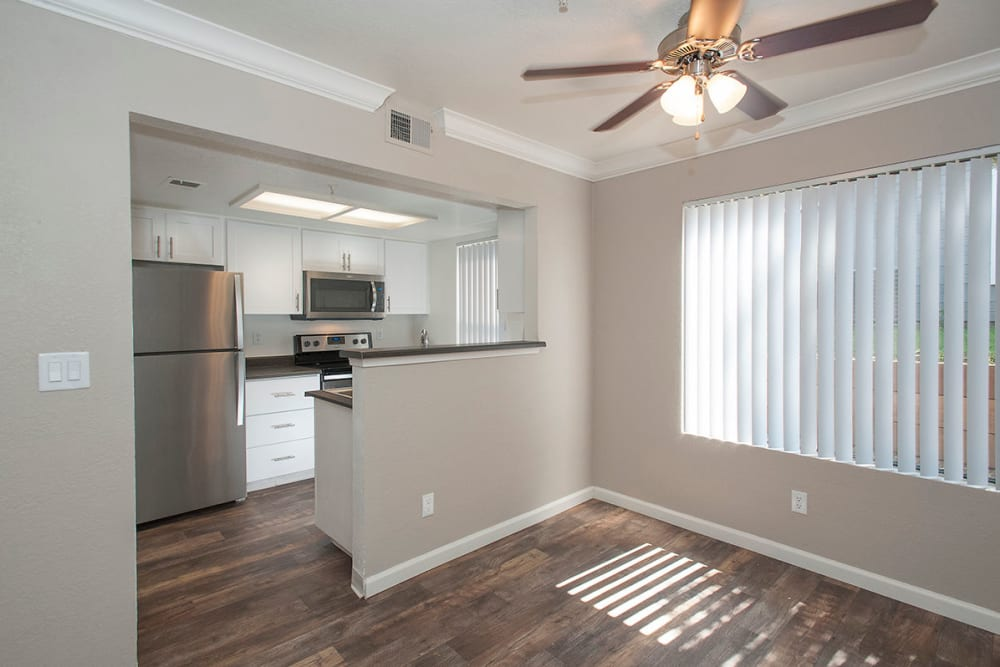 Luxury dinning room with hardwood flooring and a ceiling fan at Sandpiper Village Apartment Homes in Vacaville, California