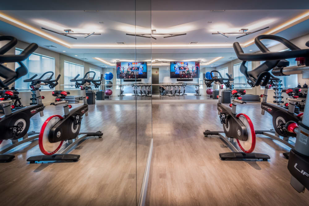 Fitness center with bikes at The Chase at Overlook Ridge in Malden, Massachusetts