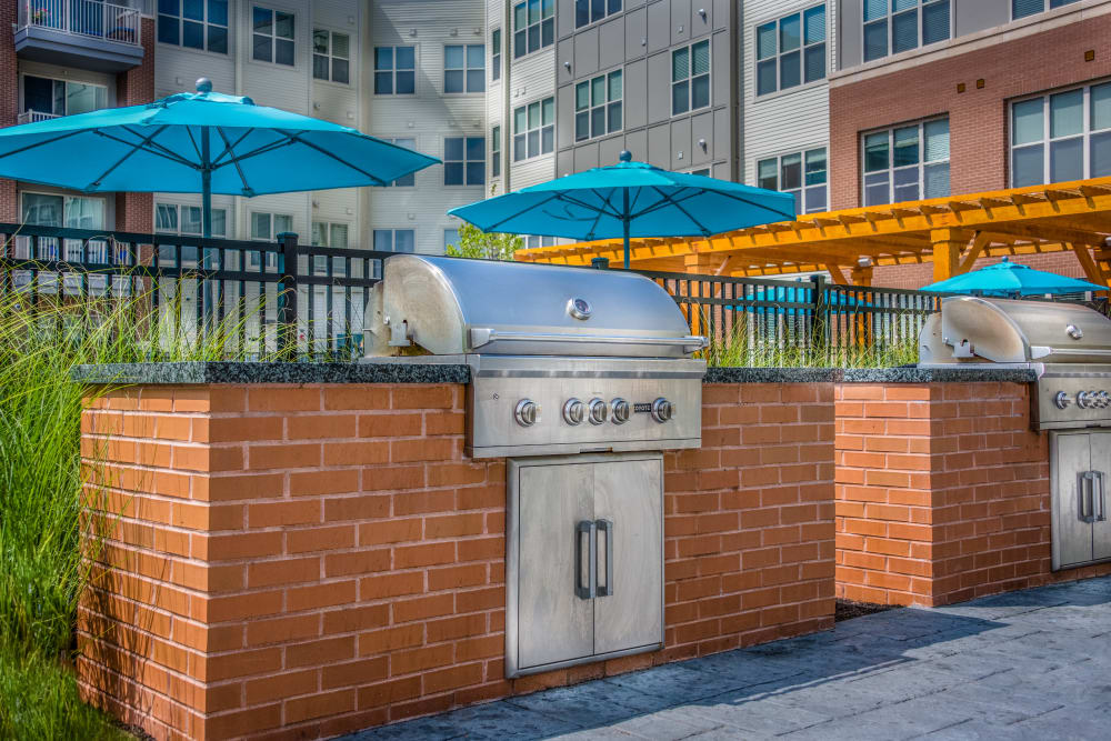 Grills by the pool at The Chase at Overlook Ridge in Malden, Massachusetts