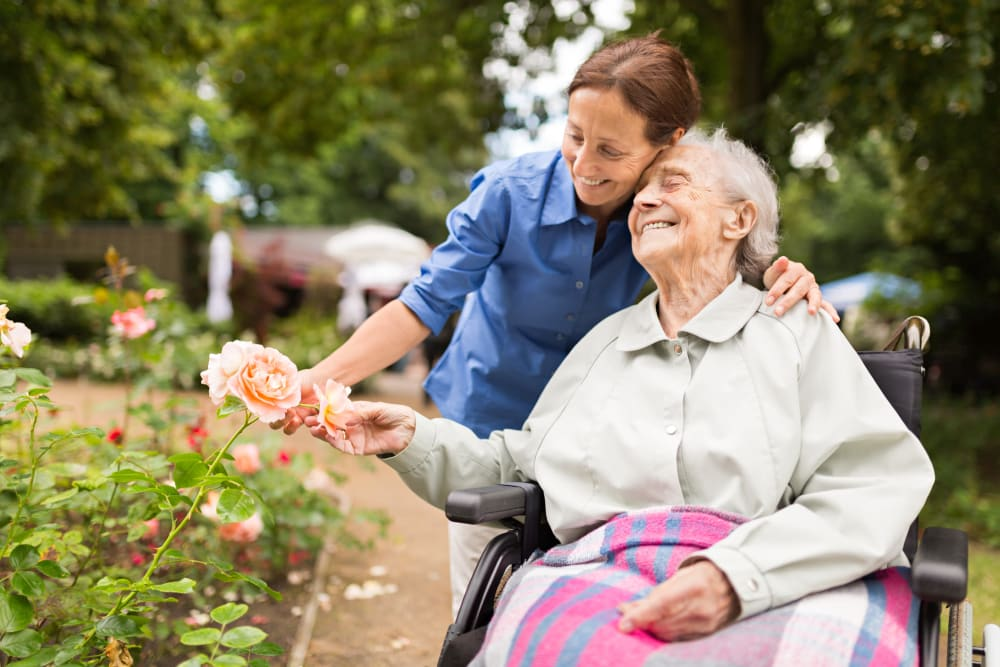 Oak Park Villages Senior Living memory care resident with her nurse in the garden.