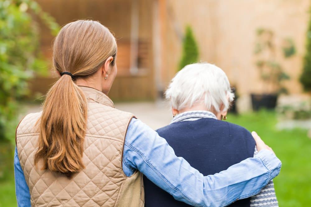 Oak Park Villages Senior Living memory care resident having a little jaunt with her caretaker.