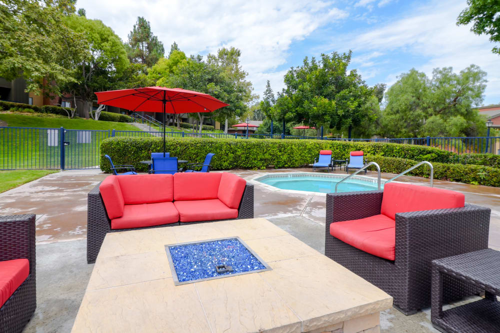 Pool side lounge with fire pit at Presidio at Rancho Del Oro in Oceanside