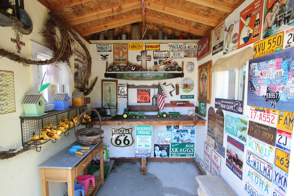 Various road signs and license plates hide inside of the tiny shed at Memory Haven