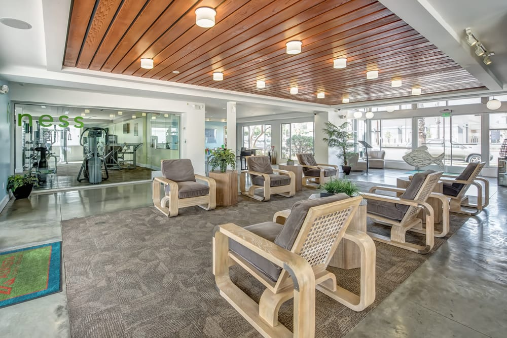 A seating area inside the leasing office at Alvista Long Beach