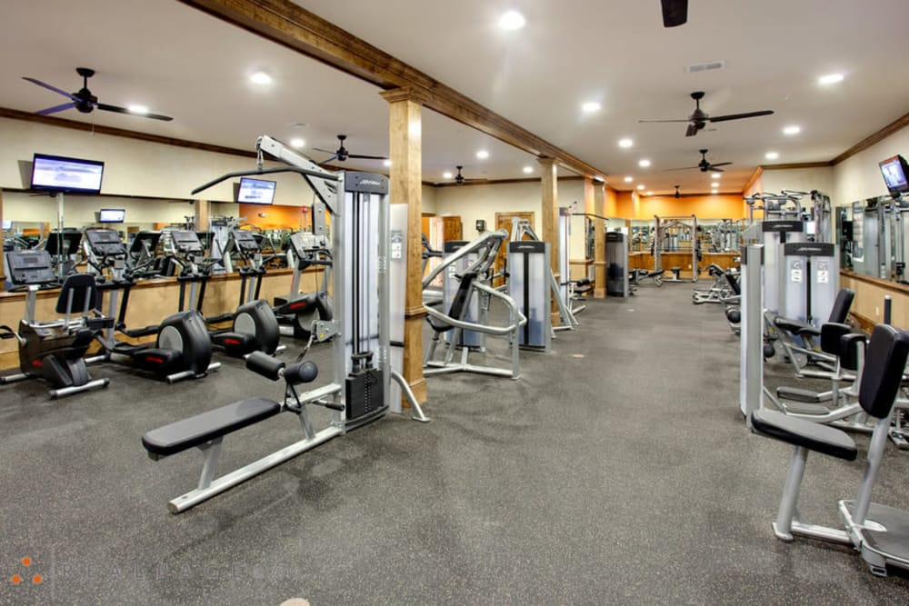 A fully-equipped fitness center at The Grove at Stone Park