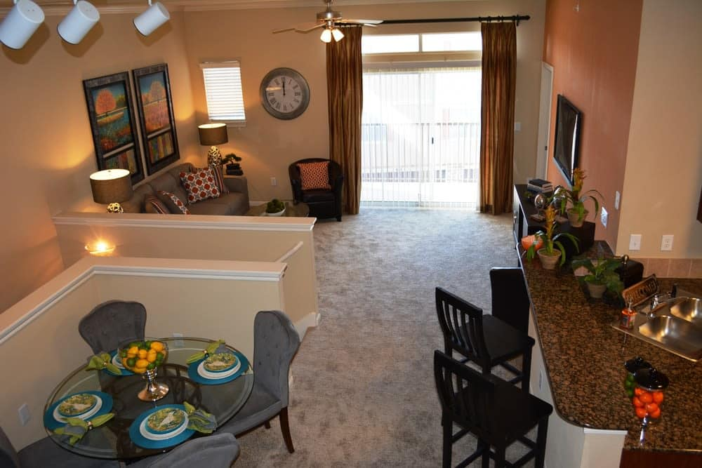 Dining and living rooms inside apartments in San Antonio