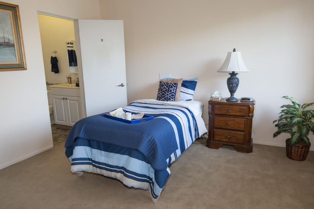 Pre-renovated bedroom at Del Obispo Terrace Senior Living in San Juan Capistrano, CA